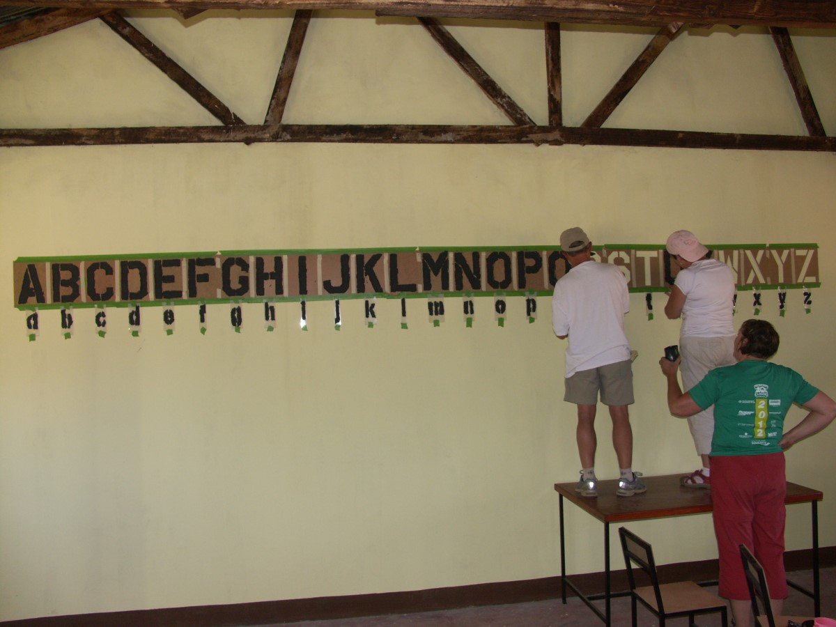 Painting the classroom walls at Oltepesi pre-school, Tanzania